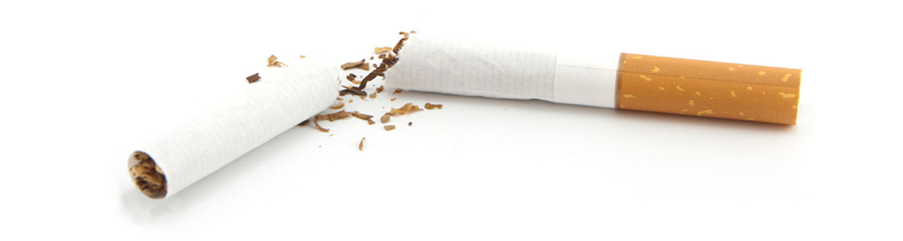 An enlarged close up of a cigarette broken in half